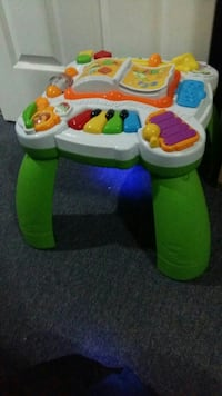 baby's white and green activity table