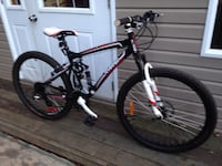 black and red hardtail mountain bike Montréal, H8Y 1H6