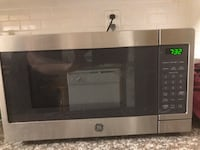 Stainless steel and black oster microwave oven Columbus, 43240