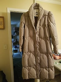 brown zip-up down filled womans coat