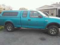 blue Ford F-150 extra cab pickup truck 63 km
