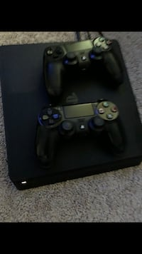 PS4 with two controllers  , N4B 2W5
