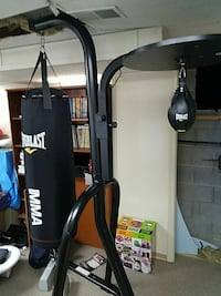 black Everlast speed bag and heavy bag with stand