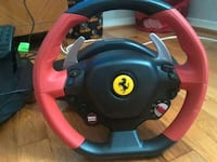red and black Ferrari steering wheel controller 49 km