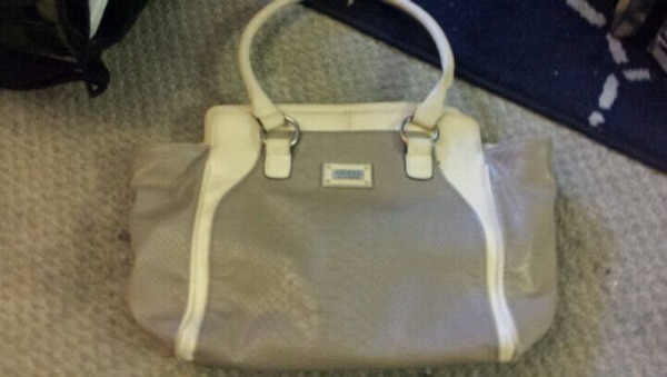 white and gray leather tote bag