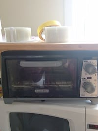 black, brow nand silver proctor silex toaster oven