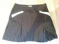 Size 4 pleated skirt with sewn in shorts