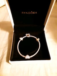 A new Pandora bracelet with three charms it real Centreville, 20121