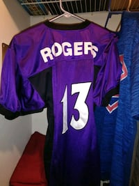 purple and white Rogers 13 jersey shirt