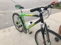 Green and black Norco mountain bike