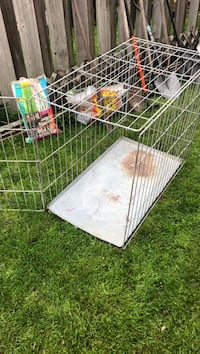 White and red metal pet cage London, N6G 3Z4