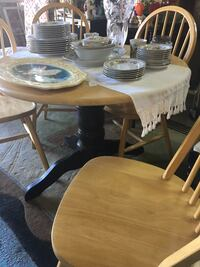 """Solid wood table with four chairs. 36"""" top. Layer chalk paint   Land O Lakes, 34639"""