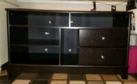 black wooden TV stand with cabinet Vista