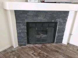 fireplace rock / tile installed Custom flooring