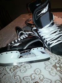 pair of black-and-white inline skates 734 km