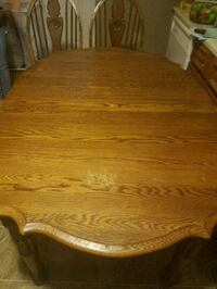 oval brown wooden dining table Sellersburg, 47172