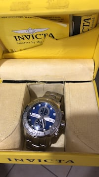 silver and blue invicta chronograph watch