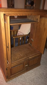 Brown wooden entertainment set with sliding doors