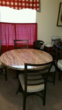 round brown wooden table with four chairs dining set Hagerstown, 21740