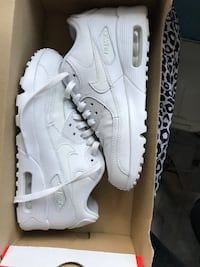 Pair of white nike air max shoes Glendale