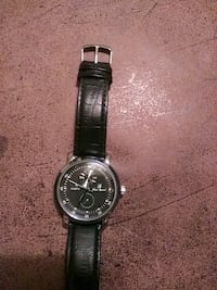 round silver analog watch with black leather strap Columbus, 43211