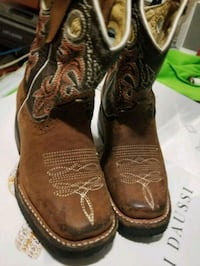 pair of brown leather cowboy boots Dallas, 75235