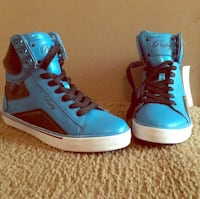 pair of blue-and-black high top sneakers Whiteville, 28472