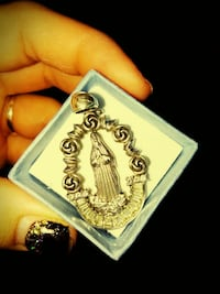 silver-colored Mother Mary pendant