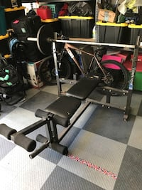 Olympic weight bench with bar and 300lbs in weight Rancho Cucamonga, 91737