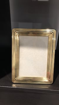 rectangular gold-colored photo frame