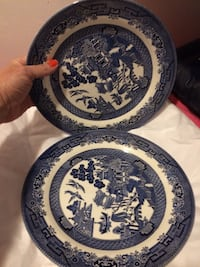 two blue and white floral ceramic plates