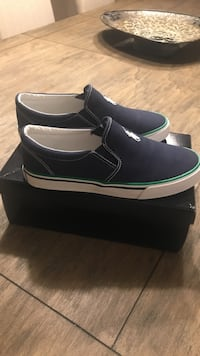 pair of black leather slip-on shoes with box Vaughan