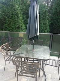 Patio table and chairs set including