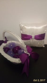 white and purple ring pillow and basket