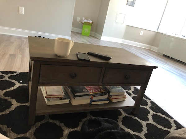 I'm selling this brand new coffee table that I literally just bought for my new apartment but it doesn't work with my colors. $100 for the coffee table alone, $150 for the table and the rug together.