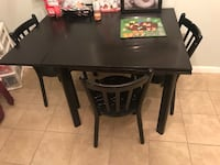 rectangular black wooden table with four chairs dining set 29 mi