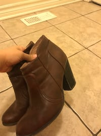pair of women's brown leather chunky-heeled boots