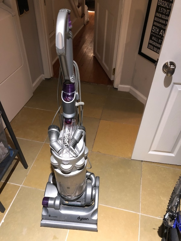 gray and purple upright vacuum cleaner