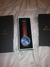 round blue Vincera chronograph watch with brown leather band