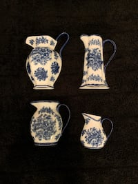 Vintage blue and white ceramics pitchers wall display set