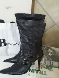 pair of black leather knee-high boots size 9 Calgary, T2J 0E3