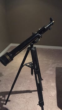 Black telescope and tripod stand