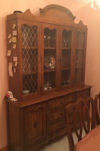 Dining room set with hutch and six chairs.
