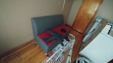 gray and teal plane toy; red and gray fabric futon