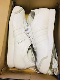 pair of white Adidas low top sneakers in box