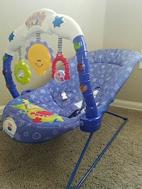 blue and white Fisher Price bouncer Brighton, 80601