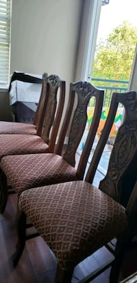two brown wooden framed gray padded chairs 2239 mi