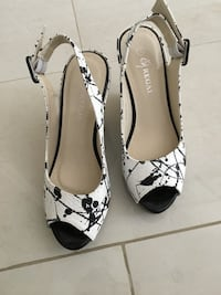 pair of white-and-black peep toe pumps Mississauga, L5M 8C3