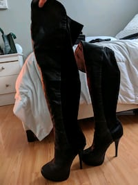Knee high stretch back boot