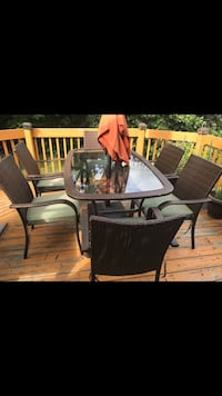 brown wooden framed glass top table with chairs Mississauga, L4Z 3Z4